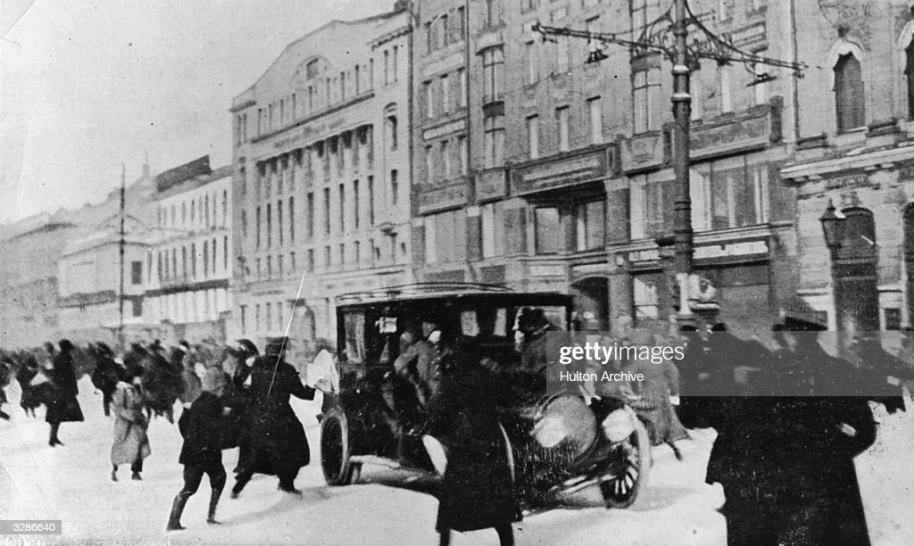 People running for cover during a gun battle on Nevsky Prospect, Petrograd (now St Petersburg), during the Russian Revolution.