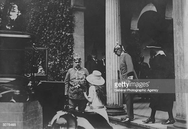 Soldier and president Paul von Beneckendorff und von Hindenburg arrives at the church for the funeral of Prince Joachim of Prussia with Marshal...