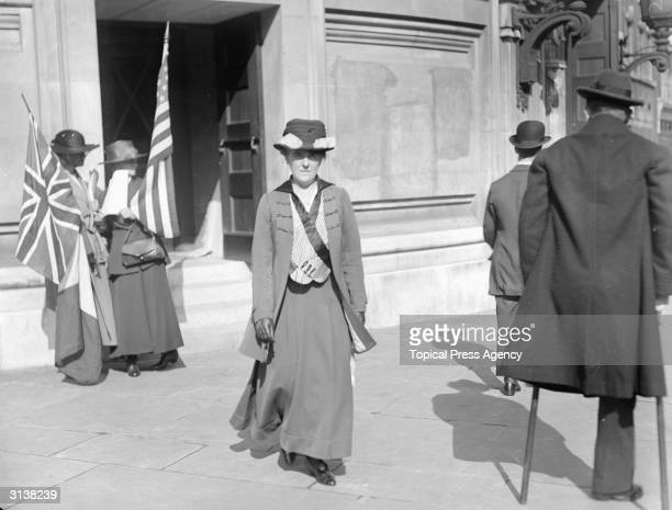 Suffragettes outside the Allied Labour Conference at Central Hall Westminster holding the Union Jack and the Stars and Stripes