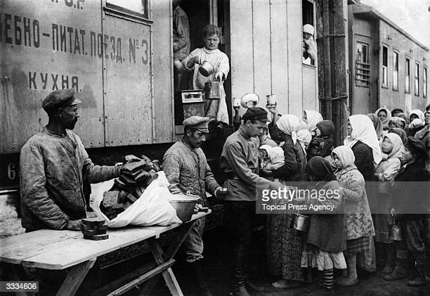 Americans distribute food from a relief train during the famine at the time of the Russian Civil War
