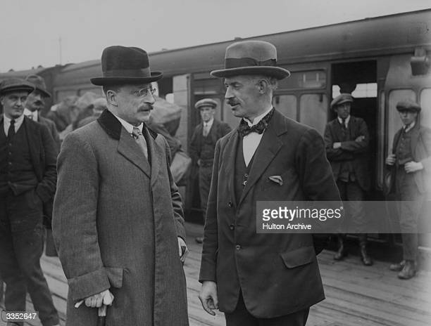 Irish journalist, founder of Sinn Fein and chief negotiator of the Irish Treaty Delegation, Arthur Griffith , talking with the delegation's legal...