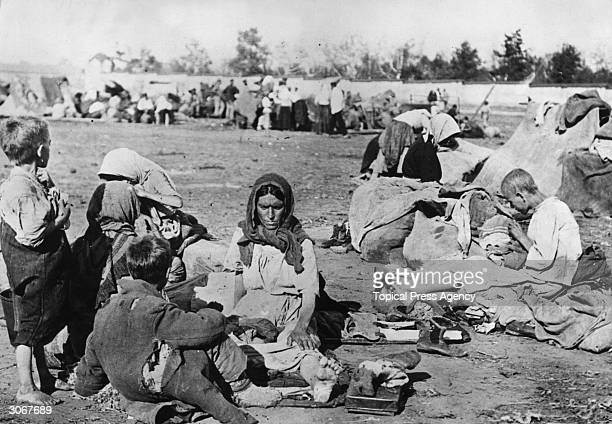 Ragged and barefoot starving Russian families in the Volga area during the Russian Famine