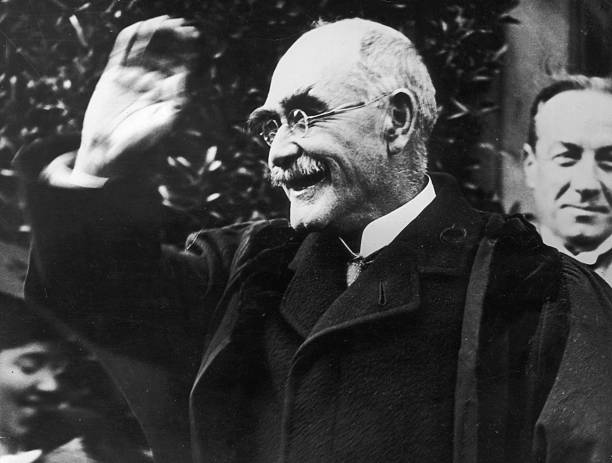 Author Rudyard Kipling smiling in acknowledgement of his appointment as Rector of St Andrew's University British Prime Minister Stanley Baldwin can...
