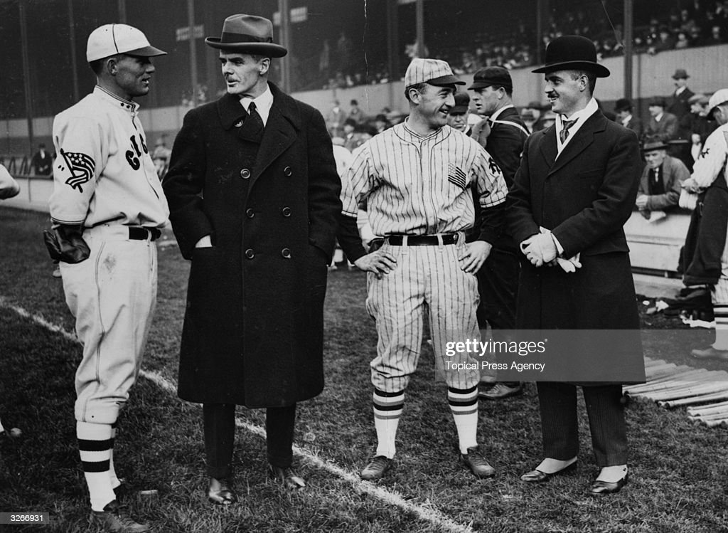 Players take a break and chat during a New York Giants v Chicago White Sox baseball game.