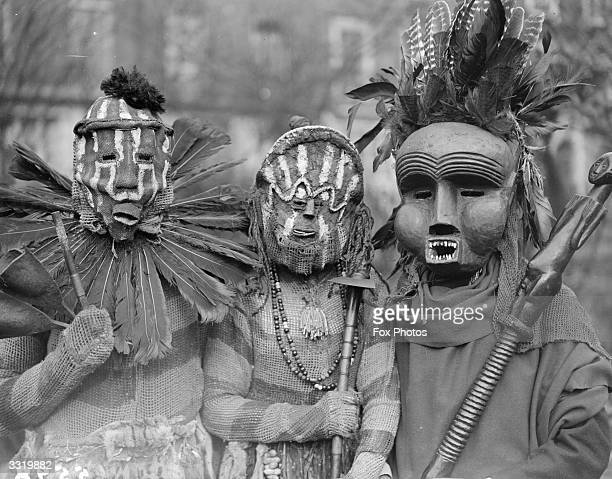 Mr Frank Worthington and companions in African witch doctor masks