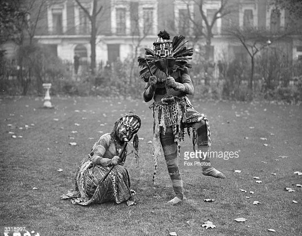 Mr Frank Worthington and female companion He is in full African witch doctor costume complete with mask and leopard skin 'skirt'
