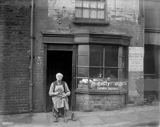 Proprietor Mr Allen in front of his shoemaker's shop in Lancelot Place Knightsbridge which established 200 years ago is the oldest boot shop in London