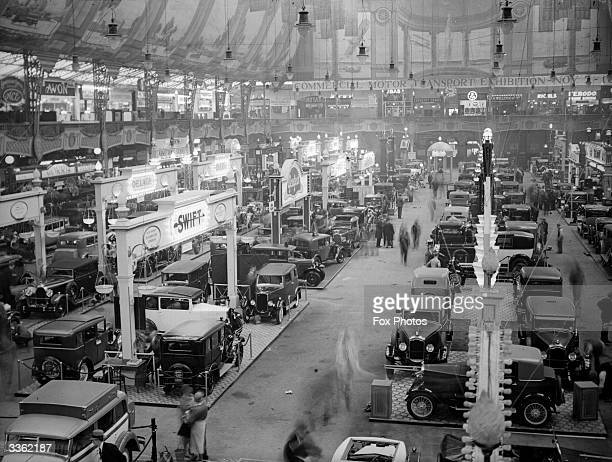Cars on display at the Motor Show at Olympia in London