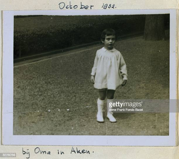 EXCLUSIVE Fulllength portrait of toddler Anne Frank outside her grandmother Alice Hollander's house taken from her photo album Aachen Germany