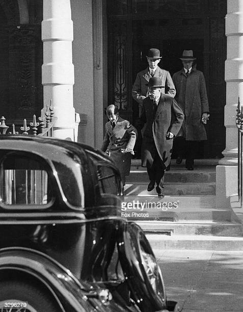 The 11 year old King Peter of Yugoslavia leaves the Yugoslavian Legation in London under guard for his school at Cobham