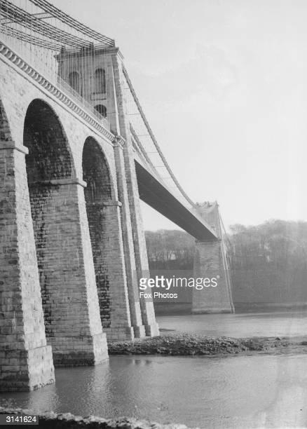 The first major suspension bridge in the world built in 18191826 by Scottish civil engineer Thomas Telford across the Menai Strait The bridge spans...