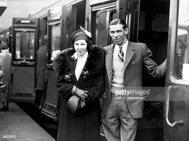 American speedway rider Jack Milne and his wife at Waterloo Station London