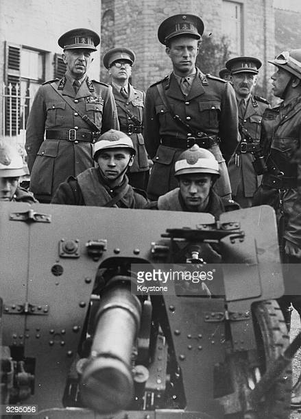 King Leopold III of Belgium attends the manoeuvres of the 8th army corps at Houx Dinant with the Minister for Defence General Denis