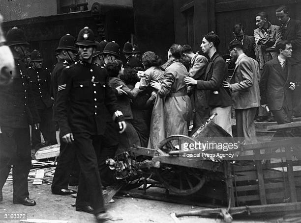 Police scuffle with women during a fascist rally held in London led by Sir Oswald Mosley