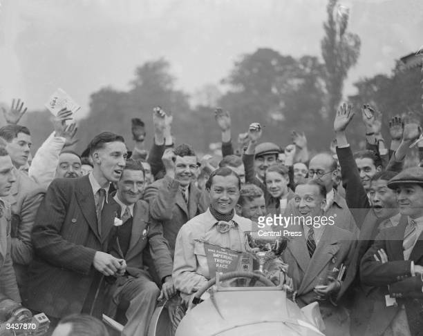 Prince Bira of Siam in jubilant mood after winning the Road Racing Club's Imperial Trophy Race at Crystal Palace