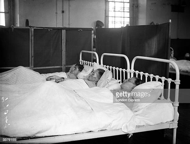Three German POWs in hospital after being shot down over Scotland in the early days of World War II.