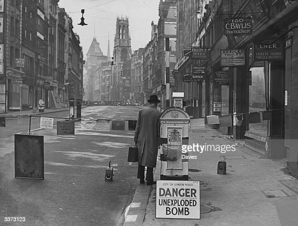 A barrier erected by police across Fleet Street in the City of London while an unexploded bomb is dealt with Signs showing the temporary addresses of...