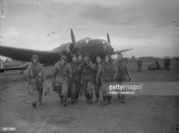 An RAF bomber crew arrives safely back after a successful night's work.