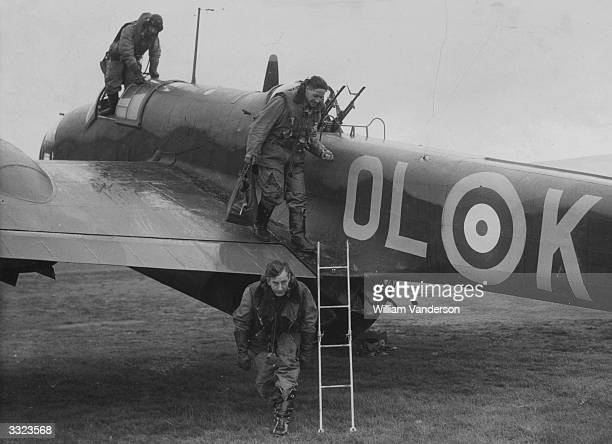 The crew of a Handley Page Hampden bomber from No 83 Squadron RAF leave their aircraft after a successful attack on Berlin and German coastal ports