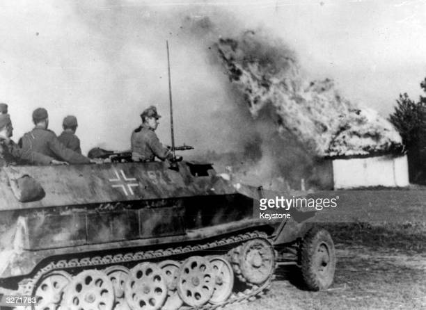 German troops making a dash to escape in the Crimea are cut off by Russian forces An armoured personnel carrier is seen rushing through a burning...