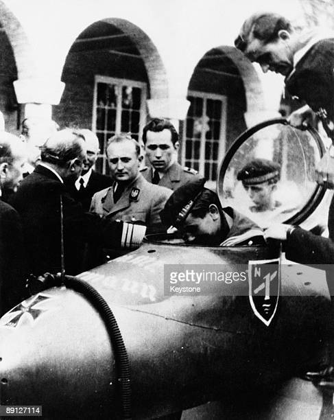 Artur Axmann leader of the Hitler Youth from 1940 to 1945 receives a visit from members of the movement who are serving as volunteers in the German...