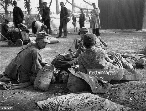 German soldiers exprisoners of war at Lehrter Station in Berlin on their return from POW camps in Russia Tobacco dries in the foreground
