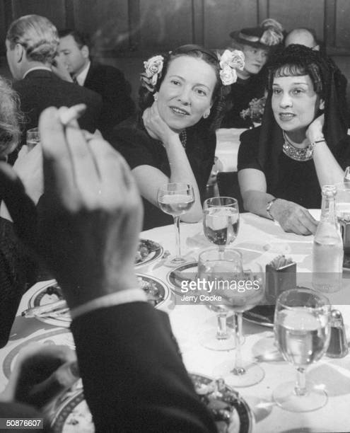 Lady Adele Astaire talking to friends while out at lunch