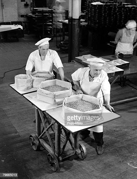 October 1947 Ingredients for Princess Elizabeth's wedding cake being wheeled to the baking ovens at a Berkshire factory