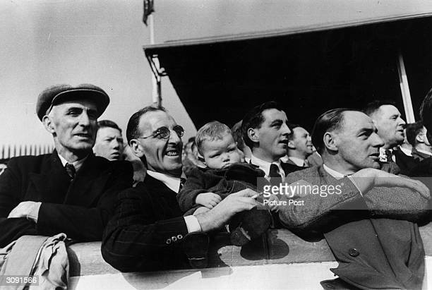 A young fan with his father in the spectators gallery at Ibrox Stadium Glasgow to watch a Rangers v Celtic football match Original Publication...