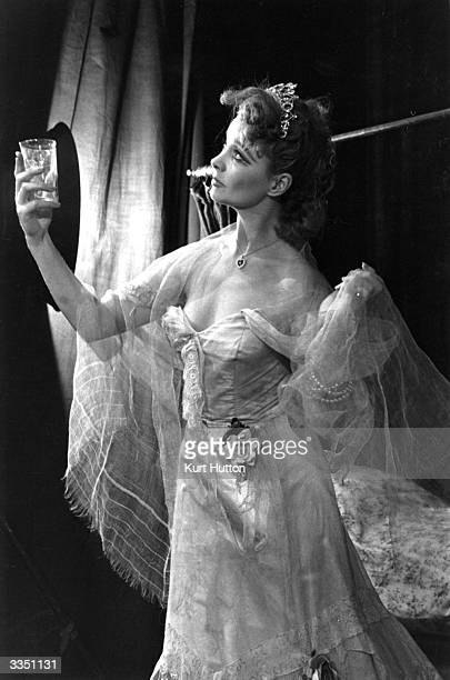 Vivien Leigh toasts the stars in her role as Blanche in 'A Streetcar Named Desire', playing at the Aldwych Theatre, London. Picture Post - 4903 -...