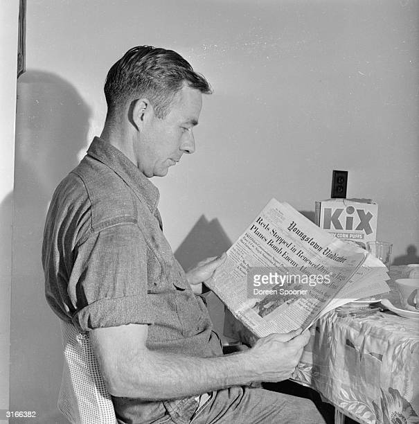 American steelworker Charlie Grapentine reading about the Korean War in the Youngstown Vindicator He earns 320 dollars per month for a 40 hour week...