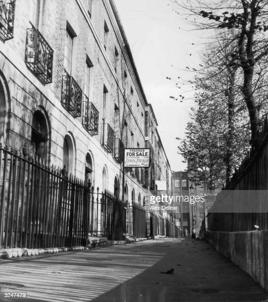 A For Sale sign outside a row of houses in Bow east London Original Publication Picture Post 8061 Bow Bells unpub