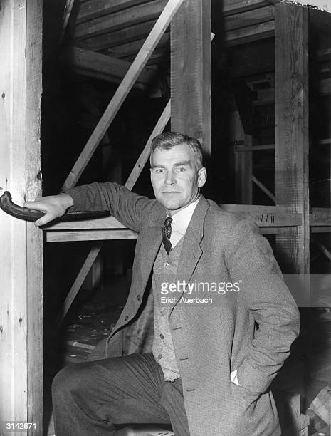Antarctic explorer Vivian Fuchs poses beside a section of the hut which he and his team will erect at Shackleton Base on the Weddell Sea at the start...