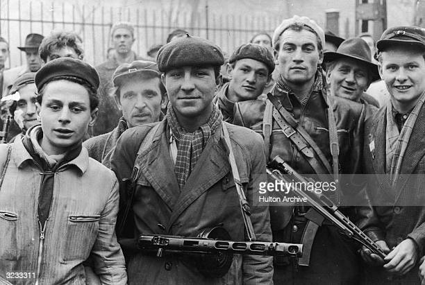 A group of armed young revolutionaries pose during the Hungarian Revolt