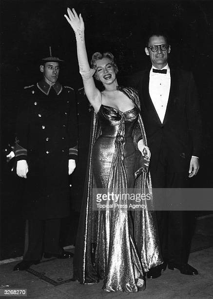 American film actress Marilyn Monroe with her husband American playwright Arthur Miller at the Royal Film Performance at The Empire Leicester Square...