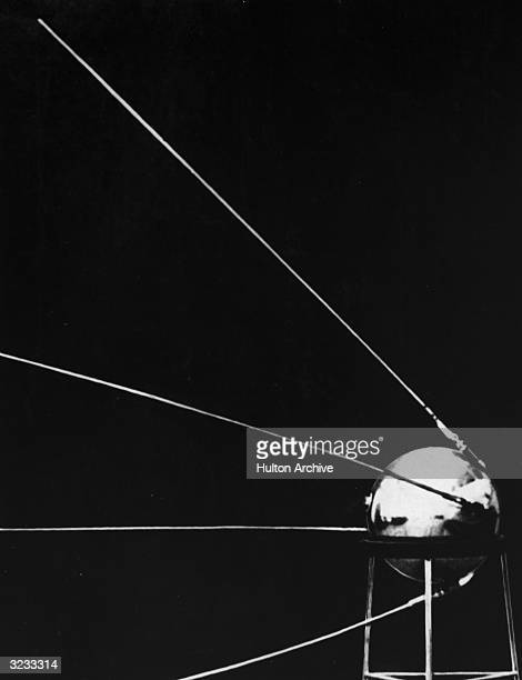 Sputnik I the first Russian satellite to enter space displayed on a stand shortly before its launch on October 4 1957