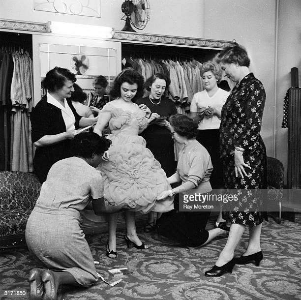 20yearold Belfast rock singer Sally Kelly is fitted for a tulle evening dress in a London fashion store
