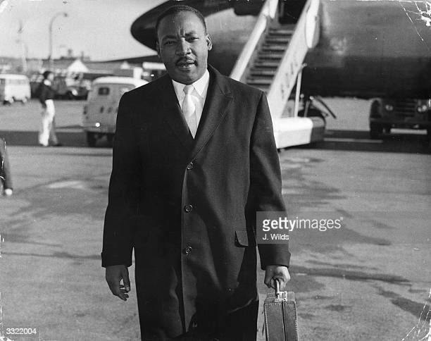 American civil rights campaigner Martin Luther King arriving at London Airport He is in England to be the chief speaker at a public meeting about...
