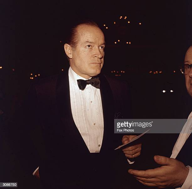 American movie icon Bob Hope arrives at a social function wearing a jacket and bow tie.