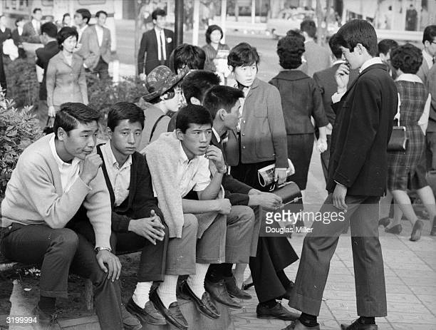Teenagers pass the time of day in central Tokyo