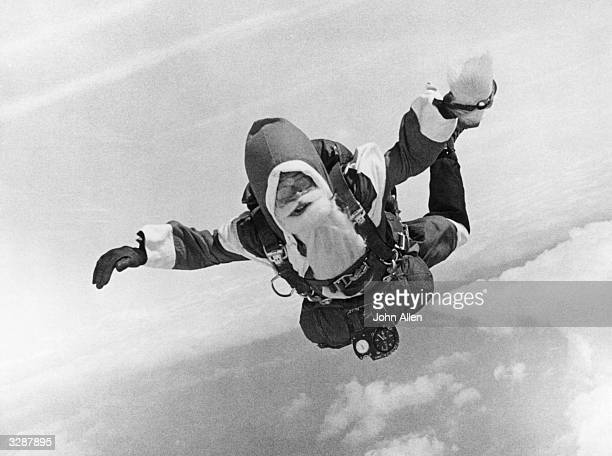 Santa Claus free falls from an aeroplane in a skydiving stunt