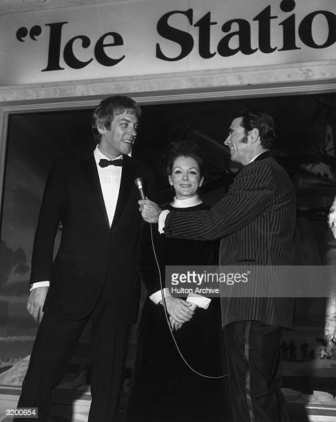 A lowangle view of Canadian actor Donald Sutherland wearing a tuxedo standing next to his first wife actor Shirley Douglas as he talks to columnist...