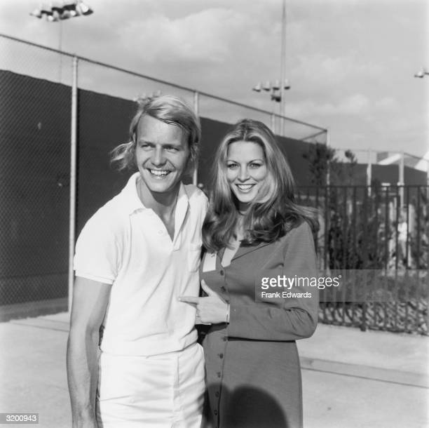 American actor and pop singer David Soul smiles with his wife Karen Carlson while attending the first Claudine Longet Celebrity Tennis Tournament at...
