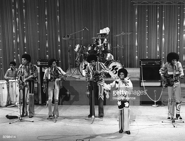 Motown pop group the Jackson Five featuring brothers Michael Jermaine Marlon Tito and Jackie performing at the London Palladium