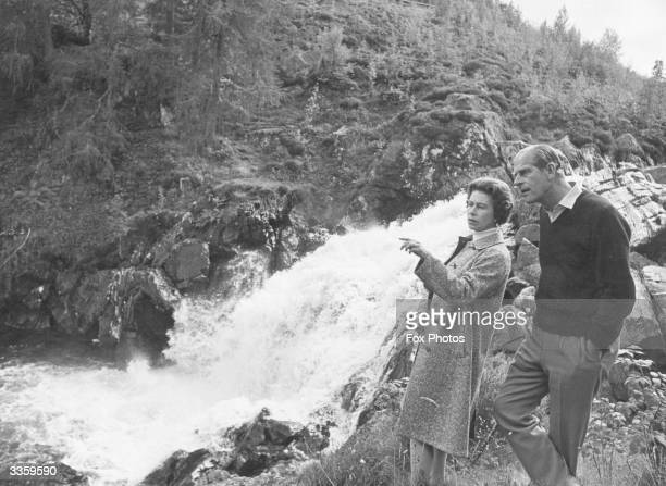 Queen Elizabeth II and Prince Philip Duke of Edinburgh by a waterfall in the grounds of Balmoral Castle Scotland Queen Victoria's husband Prince...