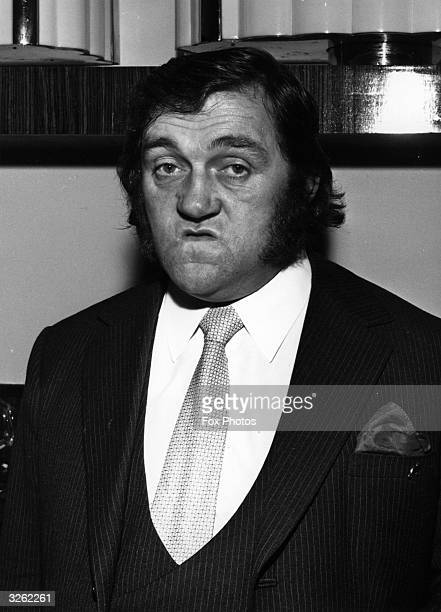 Les Dawson the British comedian wearing one of his customary 'happy' faces