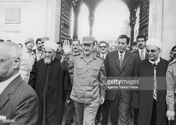 Syrian president Hafez al Assad waves as he walks with L Imana , leaving Omayyades mosque, Damascus, Syria.