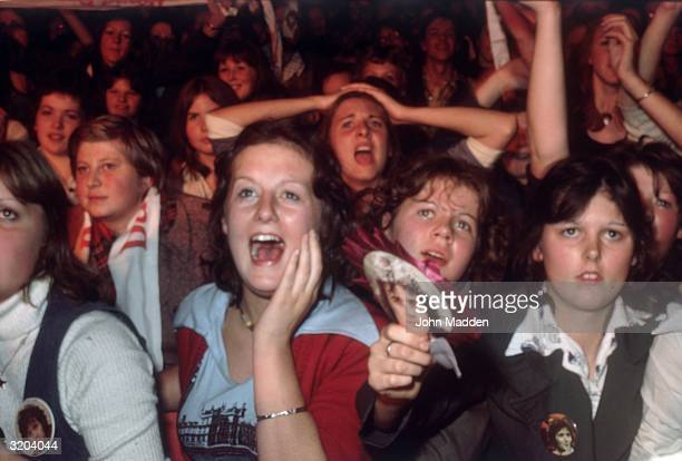 Thousands of adoring David Essex fans lose control during one of his concerts at the Belvue in Manchester