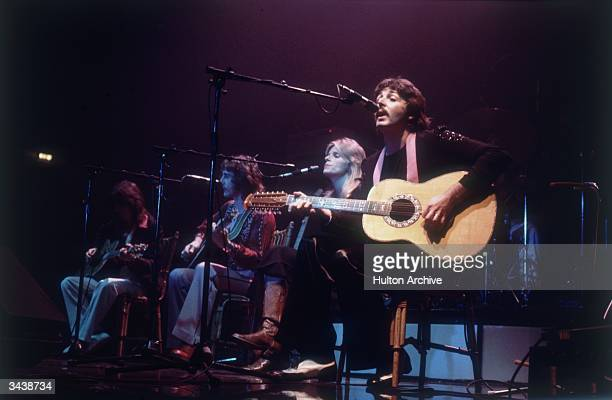 Paul McCartney his wife Linda and two guitarists performing at the Empire Pool Wembley during a Wings tour