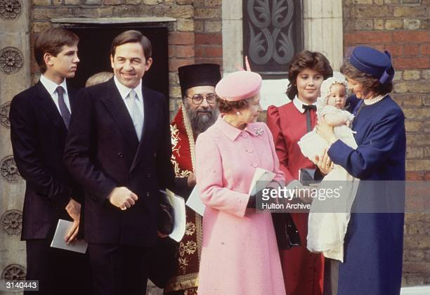 Ex King Constantine of Greece with Queen Anne-Marie and their daughter Princess Theodora at her christening. In the pink outfit is Queen Elizabeth II...